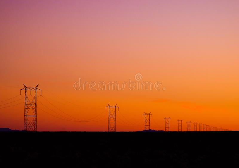 Photo of Electric Posts During Sunset stock photo
