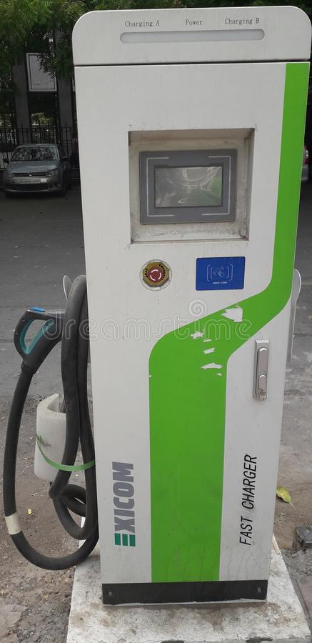 Photo of electricity car charging pump royalty free stock images