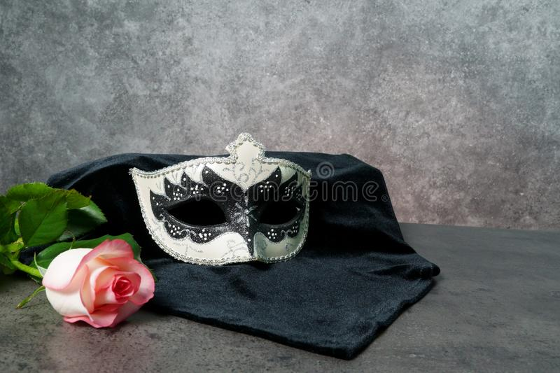 Photo of elegant white and black venetian, carnaval mask over dark background. Vintage photo royalty free stock photography