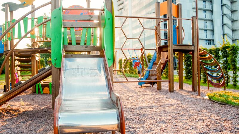 Image of empty big wooden playground at park with lots old ladders, stairs and slides stock photos