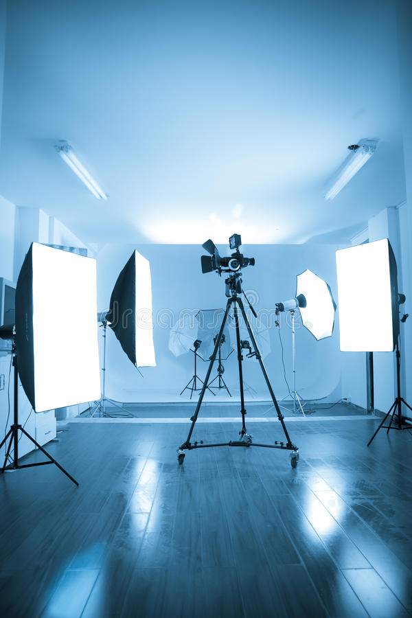 Photo of an empty photographic and video studio. Photo of an empty photographic and video studio with modern lighting equipment. Color processed royalty free stock image