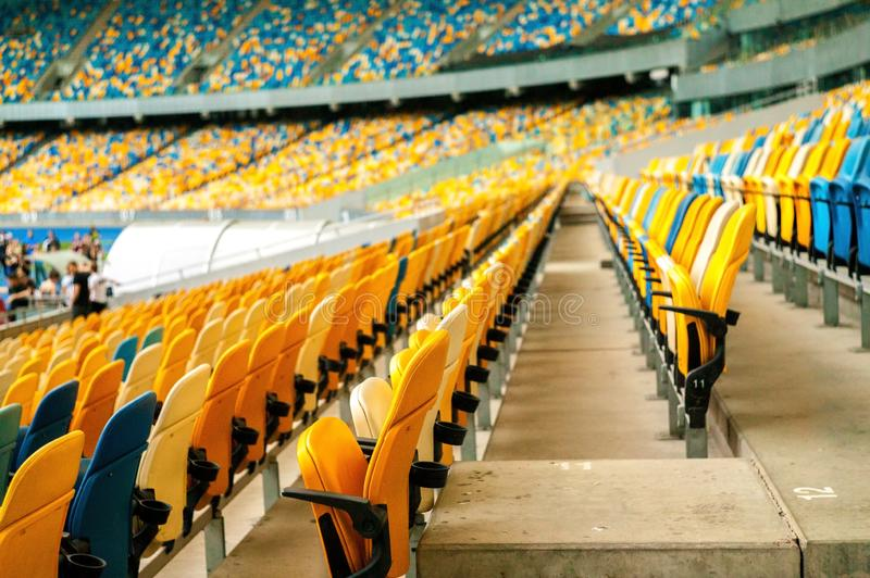 Photo of empty seats in the stadium. Photo of empty seats in the stadium, Ukraine, Kiev. Empty blue and yellow seats in stadium stock photography