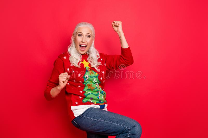 Photo of enthusiastic funky retro model granny having fun good mood gesturing raising fists up wearing jeans denim stock images