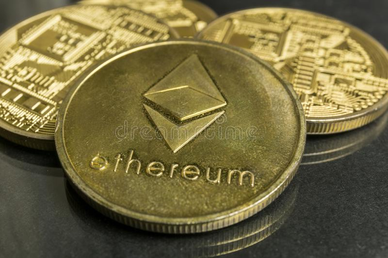 Ethereum gold coins, Blockchain Cryptocurrency concept, Ethereum news royalty free stock photo