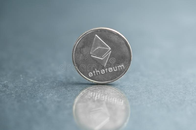 Ethereum silver coin, Blockchain Cryptocurrency concept, Ethereum news royalty free stock image