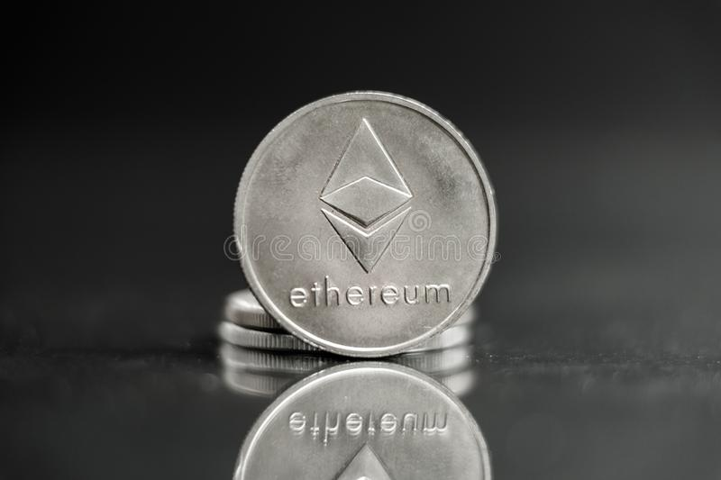 Ethereum silver coin, Blockchain Cryptocurrency concept, Ethereum news stock image