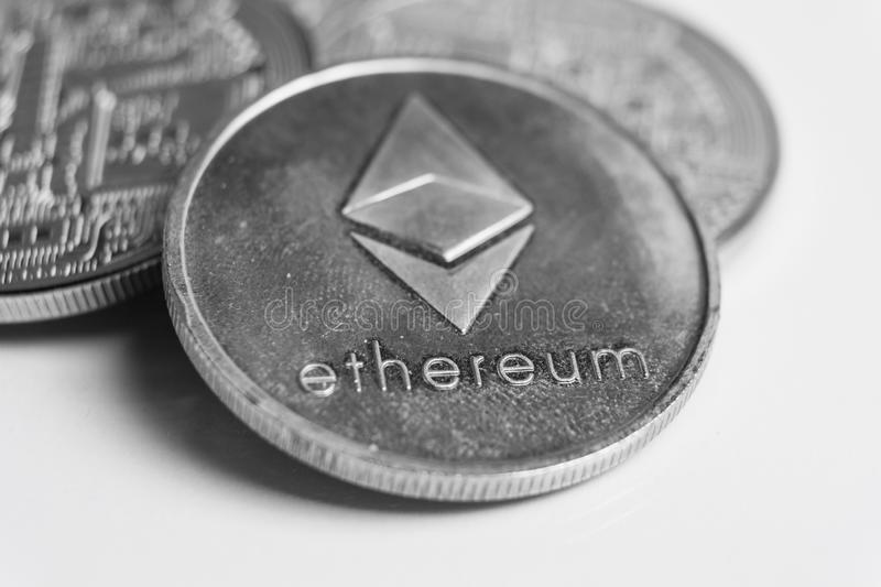 Ethereum silver coin, Blockchain Cryptocurrency concept, Ethereum news stock photography