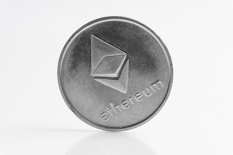 Ethereum silver coin, Blockchain Cryptocurrency concept, Ethereum news royalty free stock photography