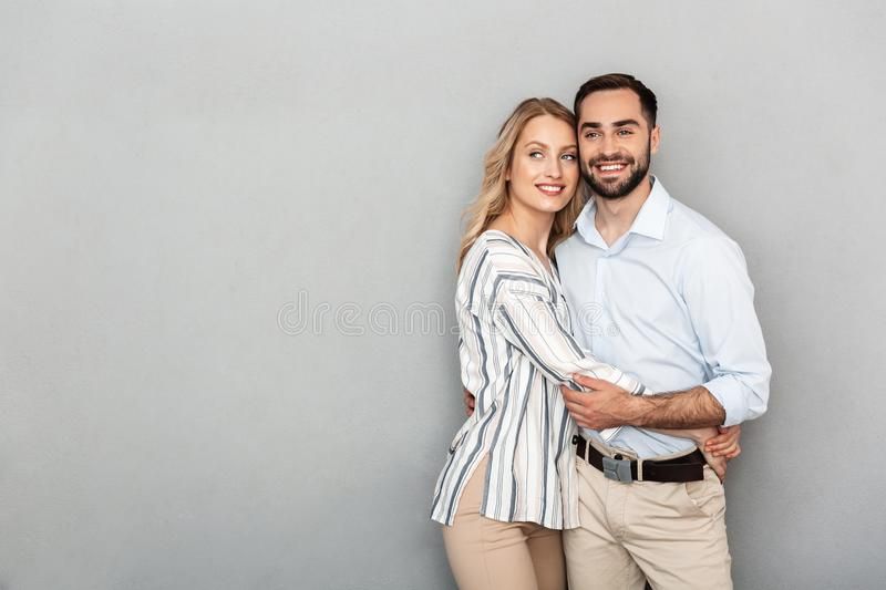 Photo of european couple in casual clothing smiling and hugging each other stock images