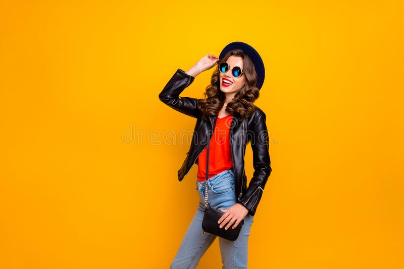 Photo of excited attractive lady holding hand on fabulous retro hat ready for voyage wear stylish outfit with shoulder royalty free stock photo