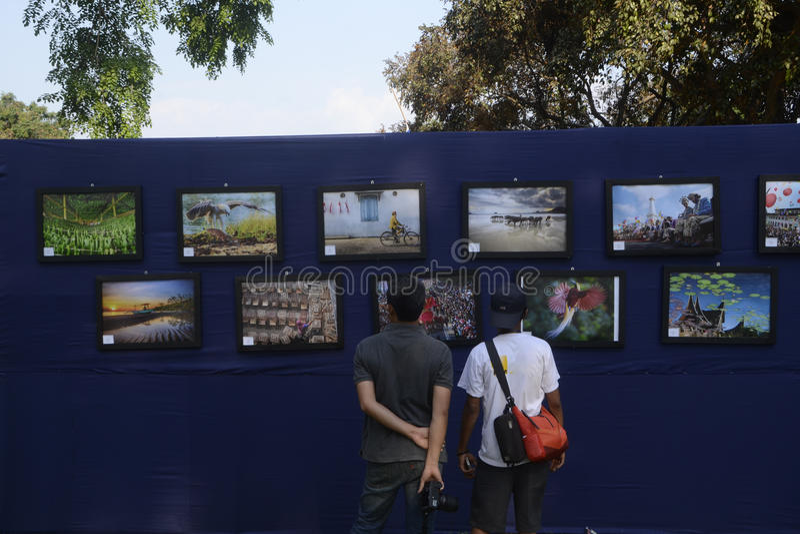 Photo exibition. Two mens looking at nikon photo exibition 2015 in yogyakarta stock image