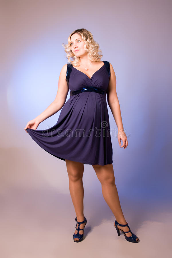 Download Photo Of Expectant Mother In A Dark Blue Dress Stock Photo - Image: 16425918