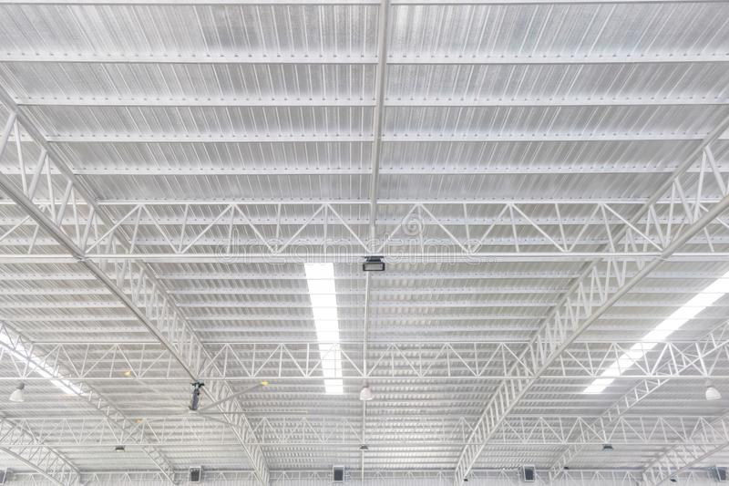 Factory`s roof structure made by steel and aluminium with lighti royalty free stock images