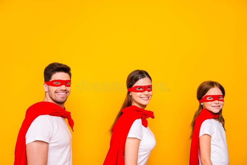 Photo of family cartoon characters carnival participants wear superhero capes isolated yellow background. Photo of family cartoon characters, carnival royalty free stock photo
