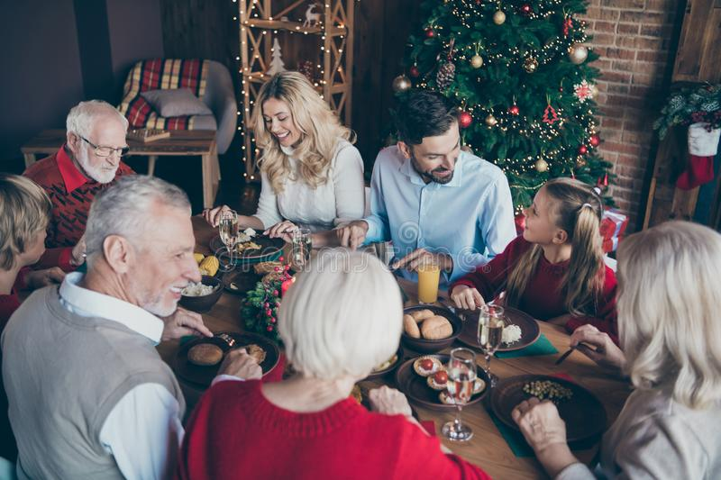 Photo of family having met gathered to celebrate new year x-mas with grandchildren grandparents speaking son and. Photo of family having met gathered to stock photography