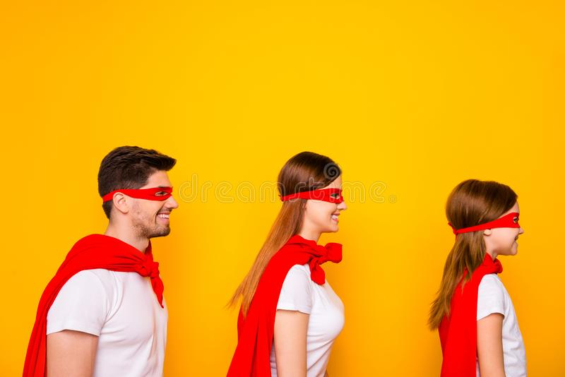 Photo of family playing cartoon characters wear superhero carnival costumes isolated yellow background. Photo of family playing cartoon, characters wear stock photo