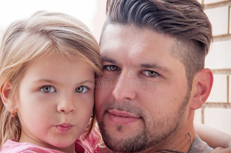 Photo of father and daughter close-up. Toghether stock image