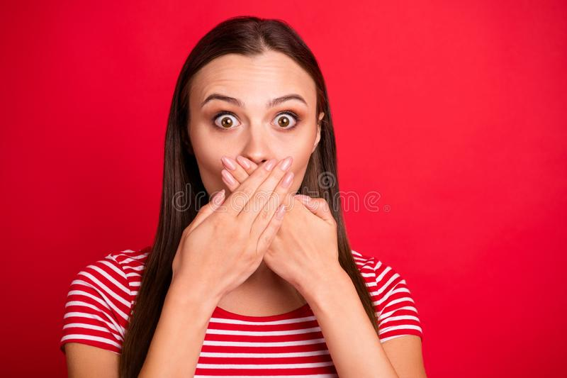 Photo of feared horrified stupor girl seeming to have told something secret wearing striped red t-shirt while isolated. Photo of feared horrified stupor girl royalty free stock photo