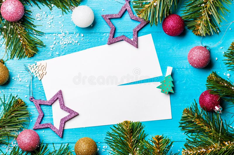 Photo of fir branches, blank paper for recordion blue royalty free stock photo