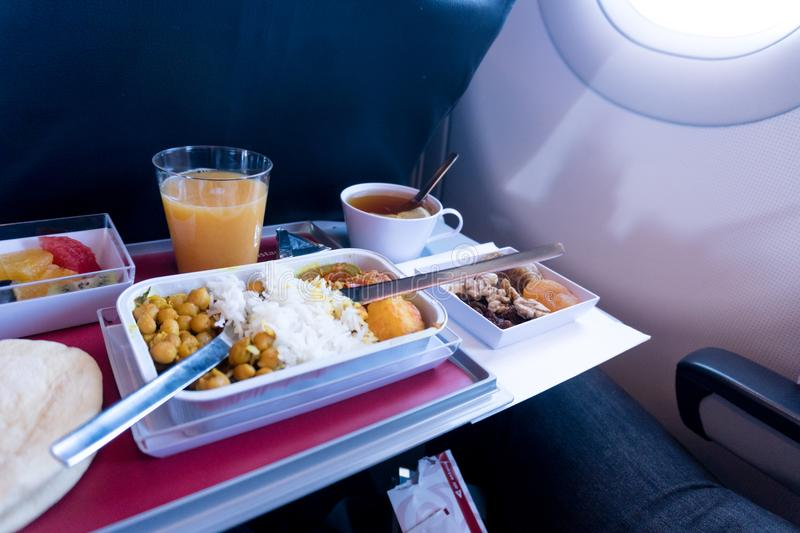 photo of Food served on board of economy class airplane on the table royalty free stock photography