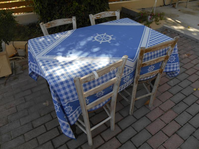 Chairs and table with detailed blue table cloth royalty free stock photos