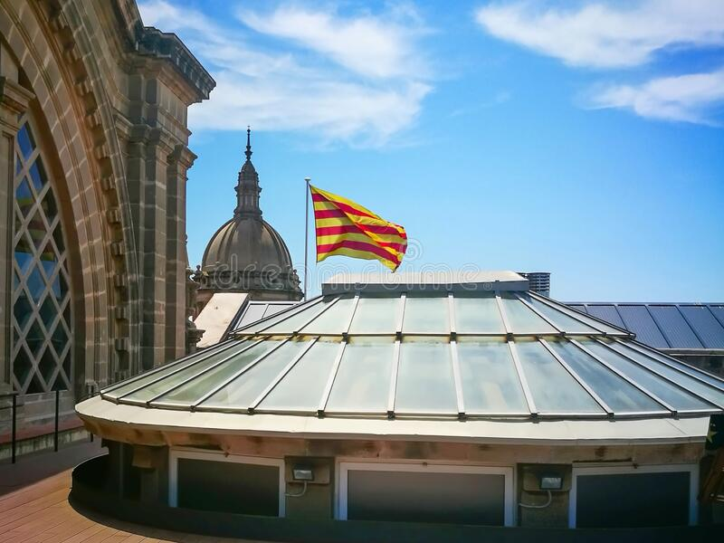 Photo of fragment Dome and official flag of Catalonia on the roof of Famous National Art Museum in Barcelona,Spain stock images