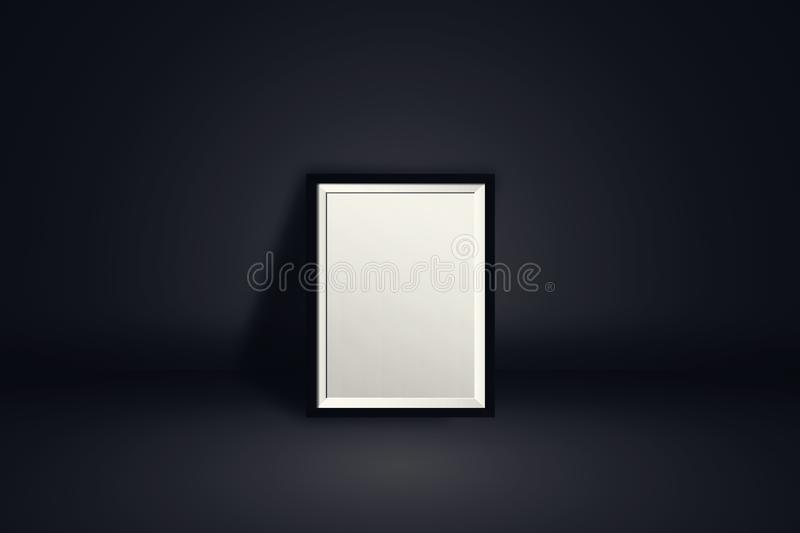 Photo frame with empty blank white screen place on black wall background for advertising and showing product. royalty free stock image