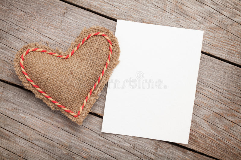 Photo frame or greeting card and valentines day toy heart. Over wooden background royalty free stock photography