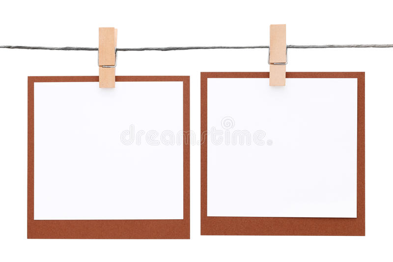 Photo frame hung on rope with clothespin. Isolated on white background royalty free stock photo