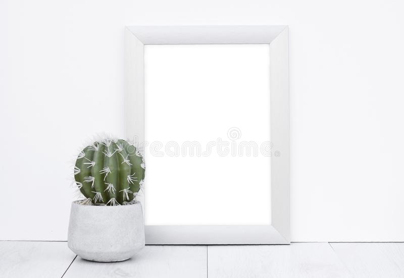 Photo frame mock up white wall background wooden grey floor with royalty free stock images