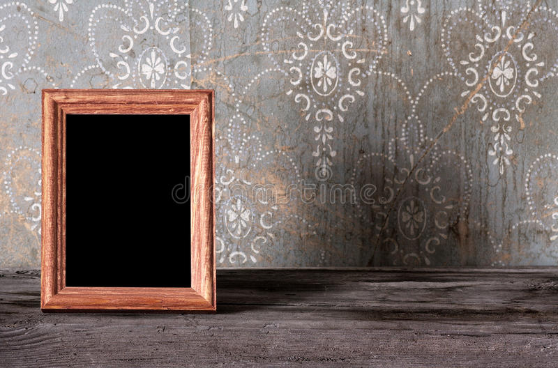 Photo-frame on old table royalty free stock photography