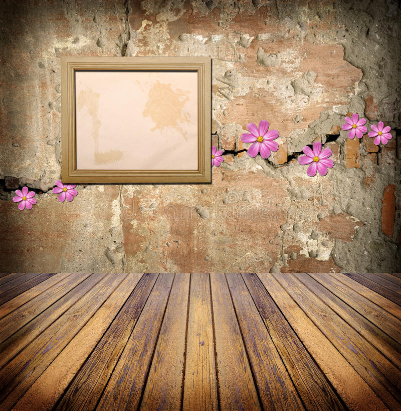 Photo frame over grunge empty room royalty free stock photo