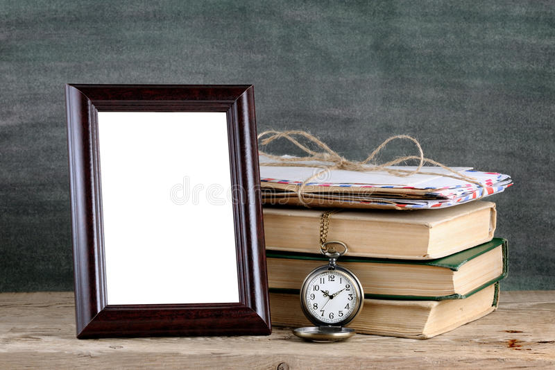 Photo frame and old books stock photography
