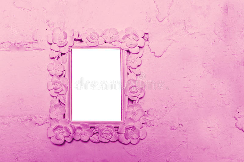 Photo frame on the pink wall with space for text.  stock photography