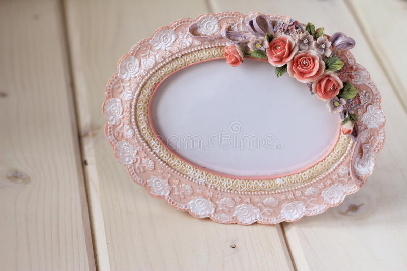 Photo frame in a romantic vintage style. On a white wooden table stock photos