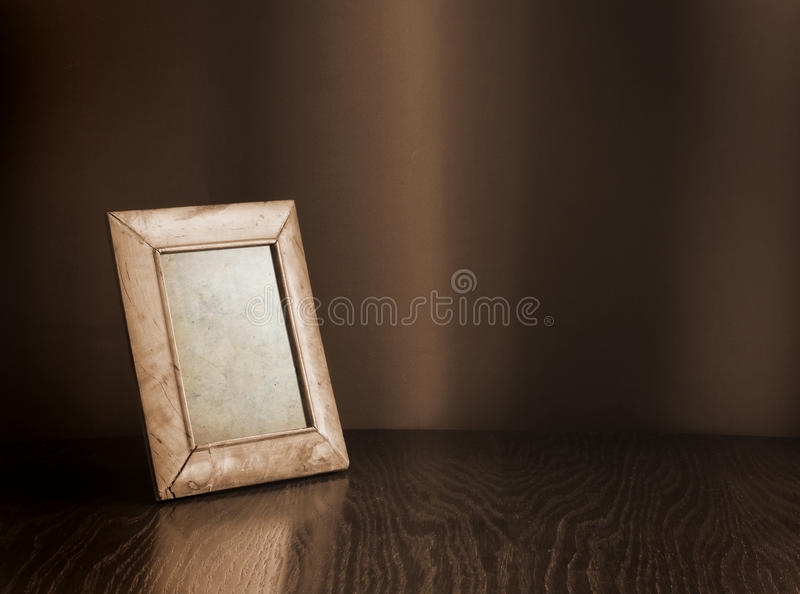 Photo-frame on table royalty free stock photo