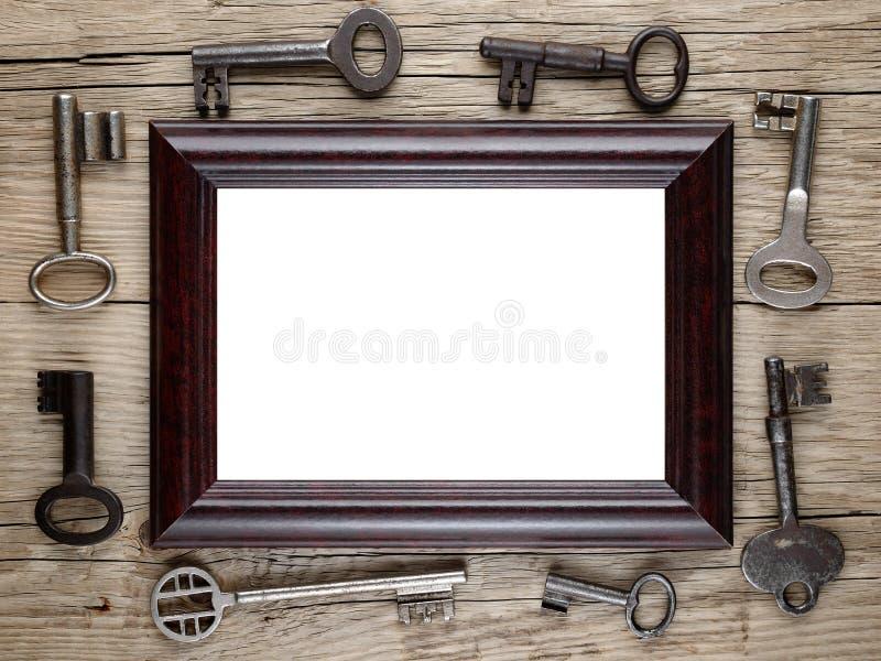 Photo frame and vintage keys stock photos