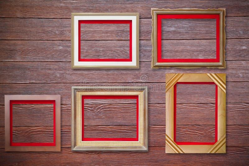 Photo frame on wood wall stock image