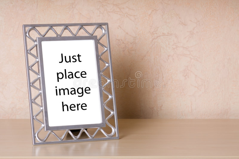 Photo frame on a wooden shelf royalty free stock photography