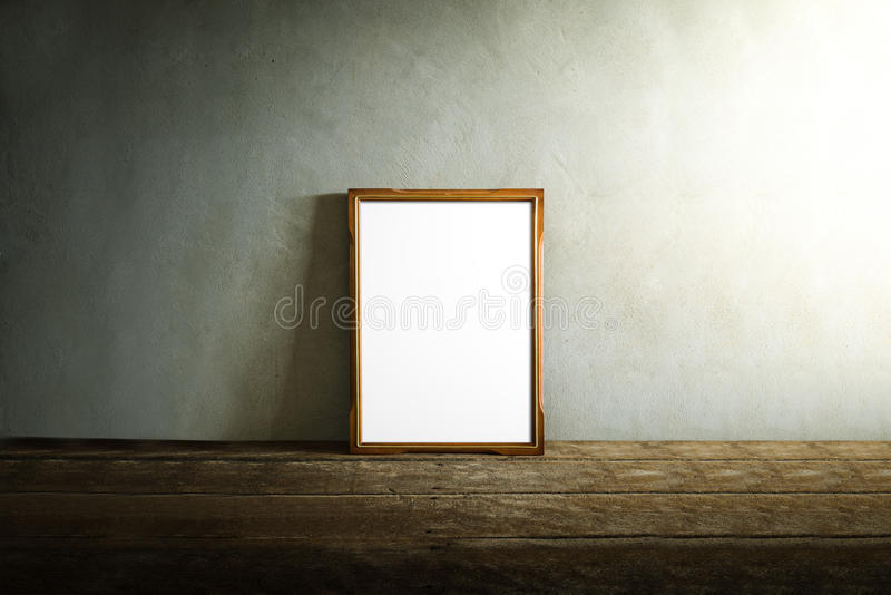 Photo frame on wooden table over grunge background stock image