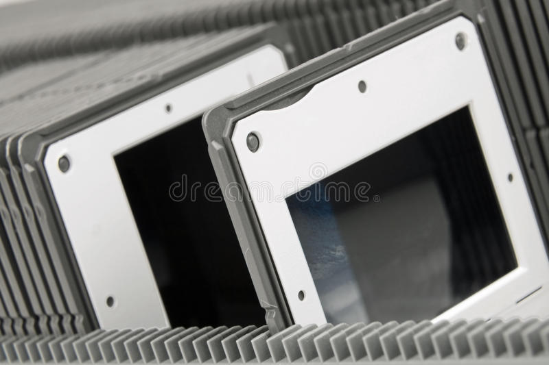 Photo frames. Stacked in the tray to the projector royalty free stock photo