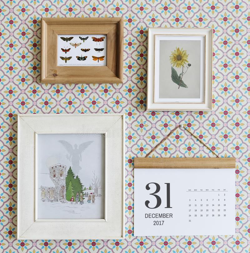 Free Photo Frames And Calendar Hanged On Wall Royalty Free Stock Photos - 105910388