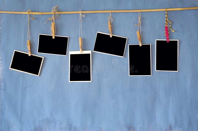 Photo frames, old blank photos on grungy wall, free space for y. Our pics and copy stock photography