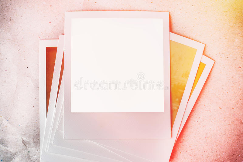 Photo frames on paper background with sun flare and warm light. royalty free illustration