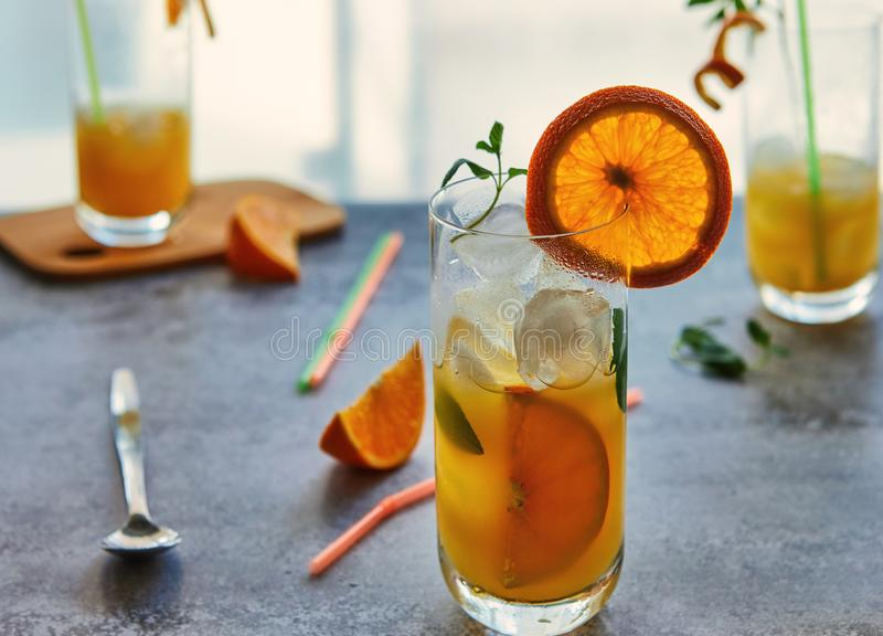 Photo of fresh orange juice in the glass jar. Summer healthy organic drink concept royalty free stock photography