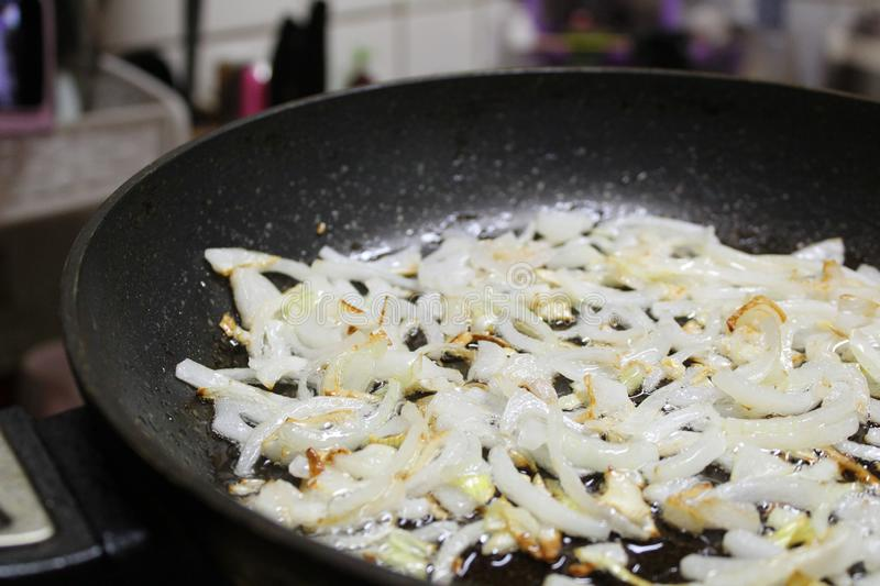 Photo of fried onions on a frying pan royalty free stock photos