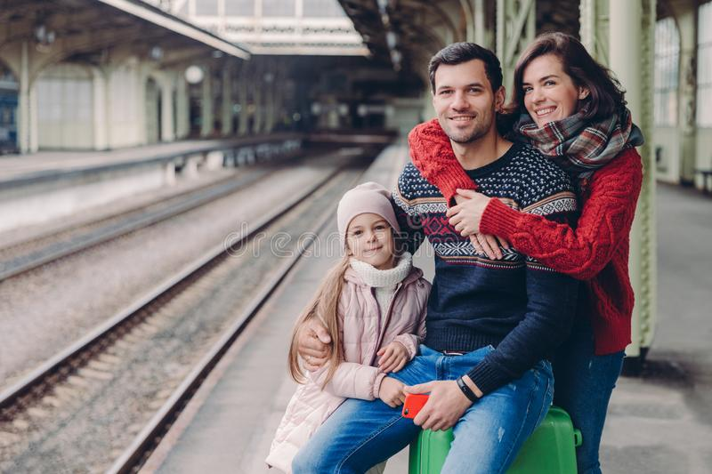 Photo of friendly family have good relationship, have trip during vacation, pose at platform of railway station. Lovely woman stock photos