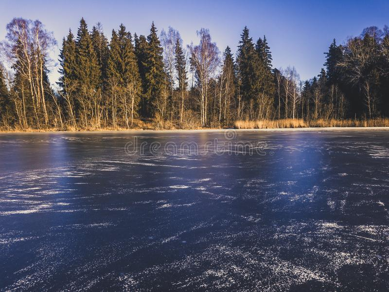 Photo of a Frozen Lake in an Autumn Day - vitage film look royalty free stock image