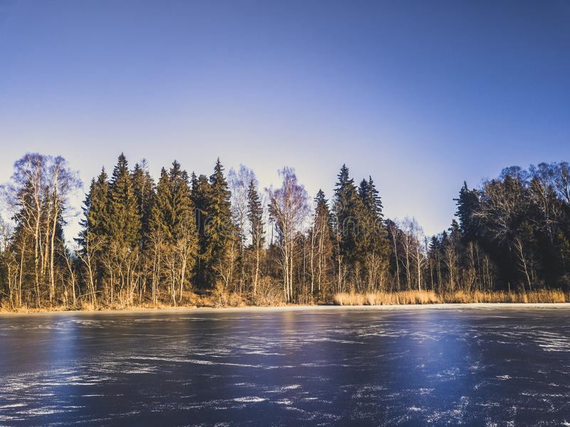 Photo of a Frozen Lake in an Autumn Day - vitage film look stock images