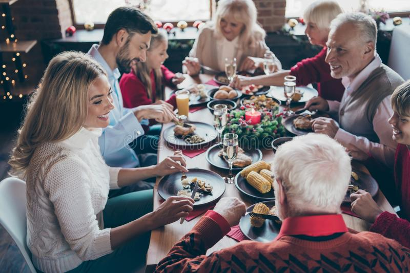 Photo of full family gathering sitting around dinner table communicating x-mas party tradition all together son daughter. Photo of full family gathering sitting royalty free stock photography